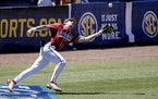 Arkansas' Cayden Wallace caught a foul ball during the Southeastern Conference championship game against Tennessee. The Razor backs were named the t