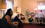Michele Preissler at the viewing for her husband Darryl, who died of COVID-19, at a funeral home in Pasadena, Md., May 26, 2021. COVID-19 hospitalizat