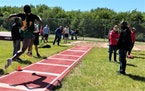 Park Center junior LauBenra Ben in the midst of a triple jump during a recent track meet.