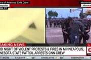 CNN reporter Omar Jimenez, in this image from television, was arrested late last spring while covering the civil unrest in Minneapolis. A security off