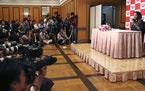 U.S. Open women's singles champion Naomi Osaka, right, attends a press conference in Yokohama, south of Tokyo, Thursday, Sept. 13, 2018. Osaka defea