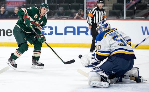 Zach Parise (11) of the Minnesota Wild attempted a shot on St. Louis Blues goalie Jordan Binnington (50) in the first period.