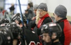 Mike Randolph, center, has resigned as coach of the Duluth East boys' hockey team after 32 seasons.