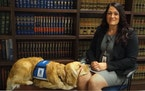 Nova and her handler Keli Trautman, who is a parlegal and victim witness coordinator with Stearns County Attorney's Office.