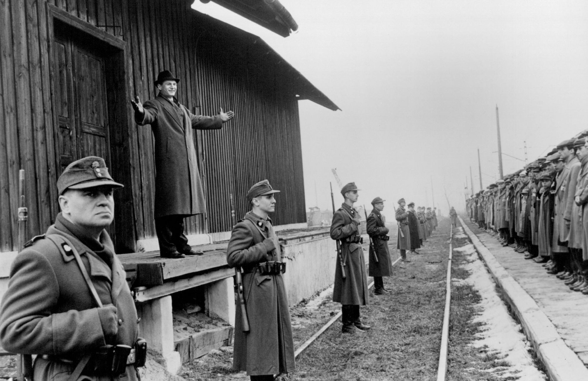 In 'Schindler's List,' German industrialist Oskar Schindler (Liam Neeson, on platform) welcomes his workers to the safety of his new factory at Brinnlitz.