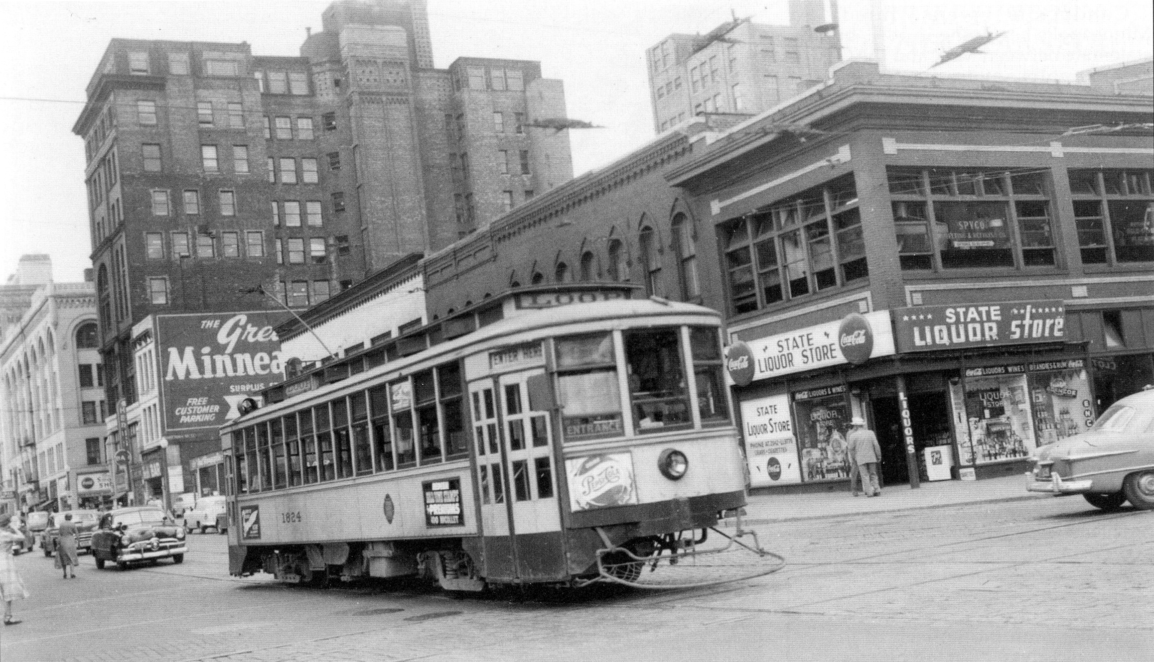 A streetcar with a 'Loop' destination sign travels downtown in 1953.