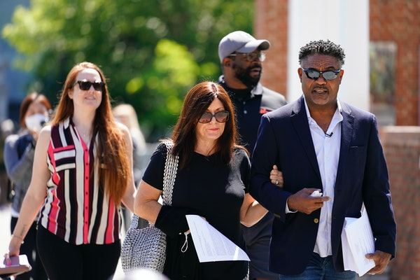 Former NFL players Ken Jenkins, right, and Clarence Vaughn III, center right, along with their wives, Amy Lewis, center, and Brooke Vaughn, left, carr