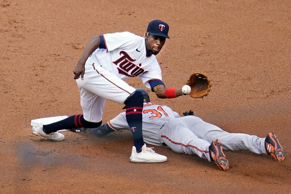 Cedric Mullins of the Orioles beat a throw to Twins second baseman Nick Gordon on May 24 at Target Field.