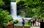 People visit Minnehaha Falls in summer 2016. This summer could look a lot more normal as people get vaccinated.