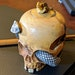 This wooden skull inkwell with an ivory snake was picked up by Chester Congdon on an overseas trip.