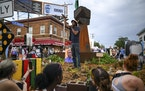 Jay Webb, a gardener and activist at George Floyd Square, spoke to a crowd of about 150 from the garden beneath the fist statue in the 38th and Chicag