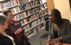 Andrea Jenkins signed books after a reading at Quatrefoil Library.