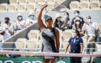 Naomi Osaka acknowledges the crowd following her win against Patricia Maria Tig in the first round of the French Open at Court Philippe Chatrier in Pa