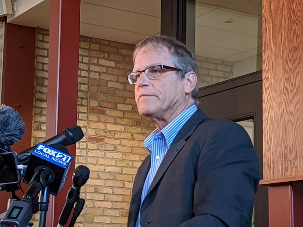 Former Duluth East hockey coach Mike Randolph spoke at a Friday news conference.