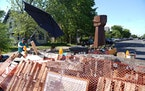 Wooden pallets, a fist sculpture and other items blocked the entrance to George Floyd Square in Minneapolis on Friday, a day after the city cleared ba