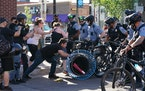 A small group of protesters who had closed the intersection of Hennepin Avenue and Lake Street in Uptown Minneapolis clashed with officers on bike as