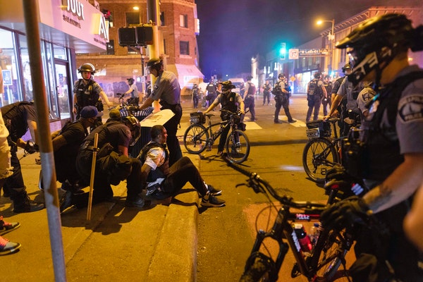 Protesters were arrested early Saturday after a vigil for Winston Boogie Smith Jr. on Friday night in the Uptown area of Minneapolis.