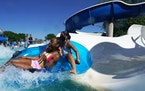 Jai'Liece Fort, 13, and her sister Jizelle Crooks, 10, flipped out of their tube as they rode the waterslides Friday afternoon at the St. Louis Park