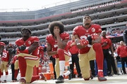 From left, 49ers outside linebacker Eli Harold, quarterback Colin Kaepernick and safety Eric Reid knelt before a game against the Cowboys in 2016.