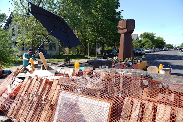 A new barricade and a new fist sculpture are at the south and north entrance to George Floyd Square a day after part of the square was cleared in Minn