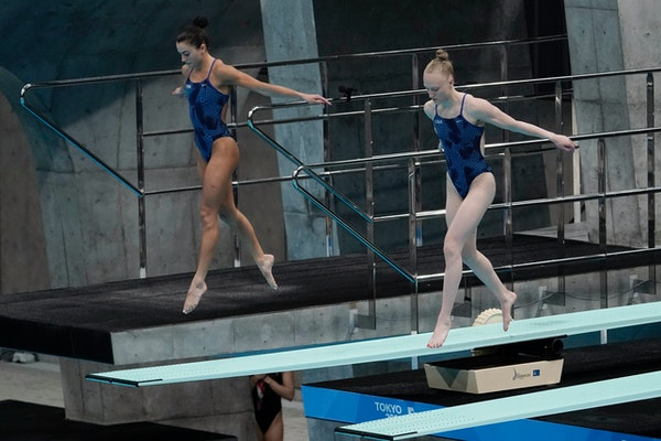 Sarah Bacon, right, and Kassidy Cook placed fifth in a World Cup 3-meter synchronized diving event in Tokyo in May, a finish that secured a U.S. berth
