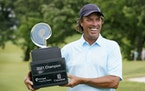 Stephen Ames holds the trophy after winning the PGA Tour Champions Principal Charity Classic in Des Moines