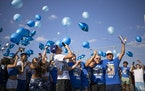 Demaris Hobbs-Ekdahl's mother, Trisha Eckdahl, center, released balloons along with her sister, Katie Eckdahl, and brother Jeff Eckdahl, right, at R