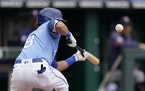 Kansas City Royals' Nicky Lopez bunts into a triple play during the third inning.