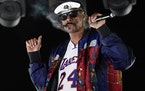 """FILE - Snoop Dogg performs a DJ set as """"DJ Snoopadelic"""" during the """"Concerts In Your Car"""" series on Oct. 2, 2020, in Ventura, Calif. The rappe"""