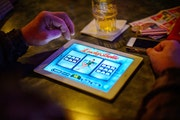 A bar patron plays electronic pulltabs in Coon Rapids. Glen Stubbe • STAR TRIBUNE