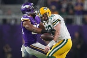 ANTHONY SOUFFLÉ • anthonysouffle@startribune.com Green Bay Packers quarterback Aaron Rodgers (12) was sacked by Minnesota Vikings defensive end Dan