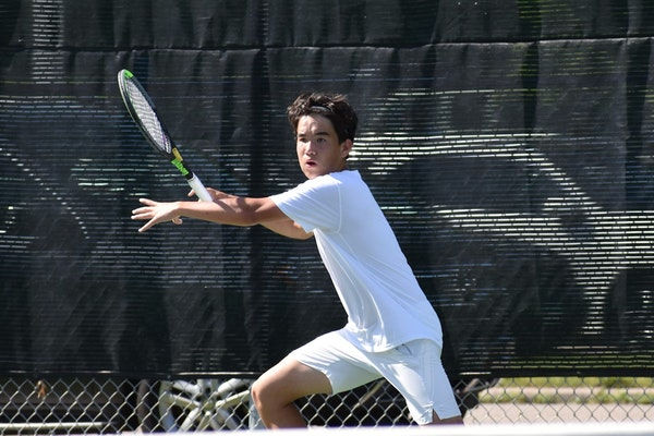 Edina sophomore Matthew Fullerton prepared to hit a forehand in the Class 2A, Section 6 championship match.
