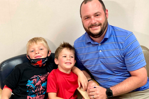 From left, 7-year-old Russell Bright, 5-year-old Tucker Bright, and dad Adam Bright pose for a picture at Ochsner Medical Center in Jefferson, La., Mo