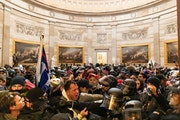 Police clash with Trump supporters who breached security and entered the U.S. Capitol building on Jan. 6, 2021. (Photo by Mostafa Bassim/Anadolu Agenc