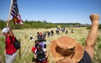 Indigenous leaders and other protesters marched to the boardwalk leading to an Enbridge pipeline construction site on Monday.
