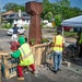 A crew from Agape arrives at George Floyd Square in June and attempts to remove shipping pallets placed on 38th Street to block traffic.