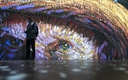 Projections of selected works of celebrated painter Vincent Van Gogh are displayed at a preview of the Immersive Van Gogh exhibit at Pier 36, Friday,
