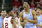 North Carolina's Sterling Manley reacts following his basket and a foul against North Carolina State