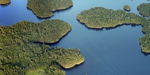 A boat navigates the waters of Namakan Lake near Kettle Falls in Voyageurs National Park.