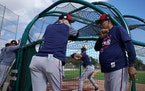 Rod Carew discussed hitting with Twins manager Rocco Baldelli in Fort Myers.
