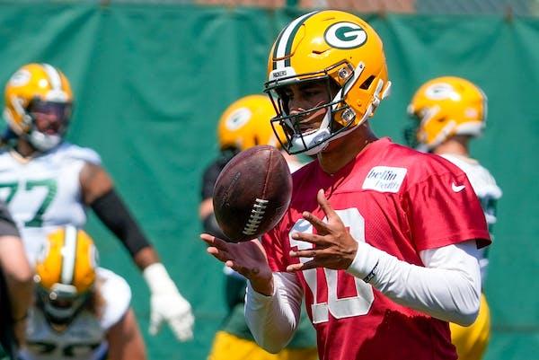 Green Bay Packers' Jordan Love runs a drill during minicamp.