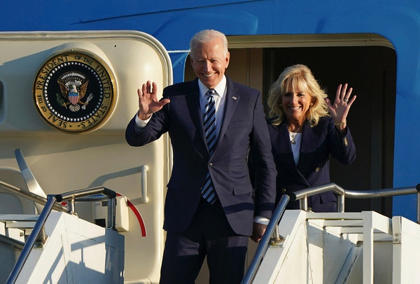 US President Joe Biden and First Lady Jill Biden wave as they arrive aboard Air Force One at RAF Mildenhall, England, ahead of the G7 summit in Cornwa