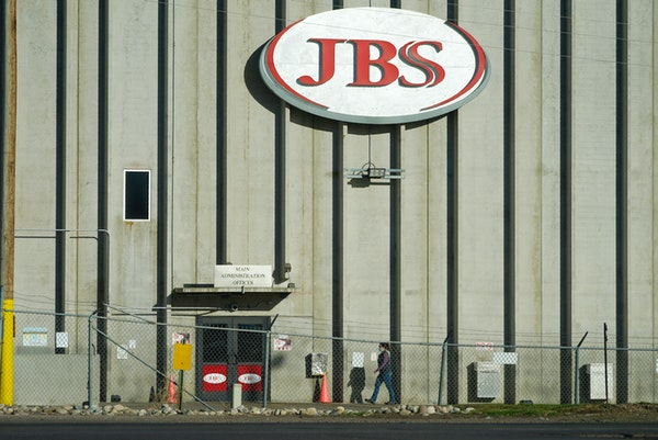 In 2020 photo, a worker heads into the JBS meatpacking plant in Greeley, Colo.