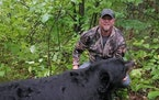 A photo that circulated on Facebook showed Brett Stimac posing with the bear federal authorities say was illegally killed.  Credit: U.S. District Cour