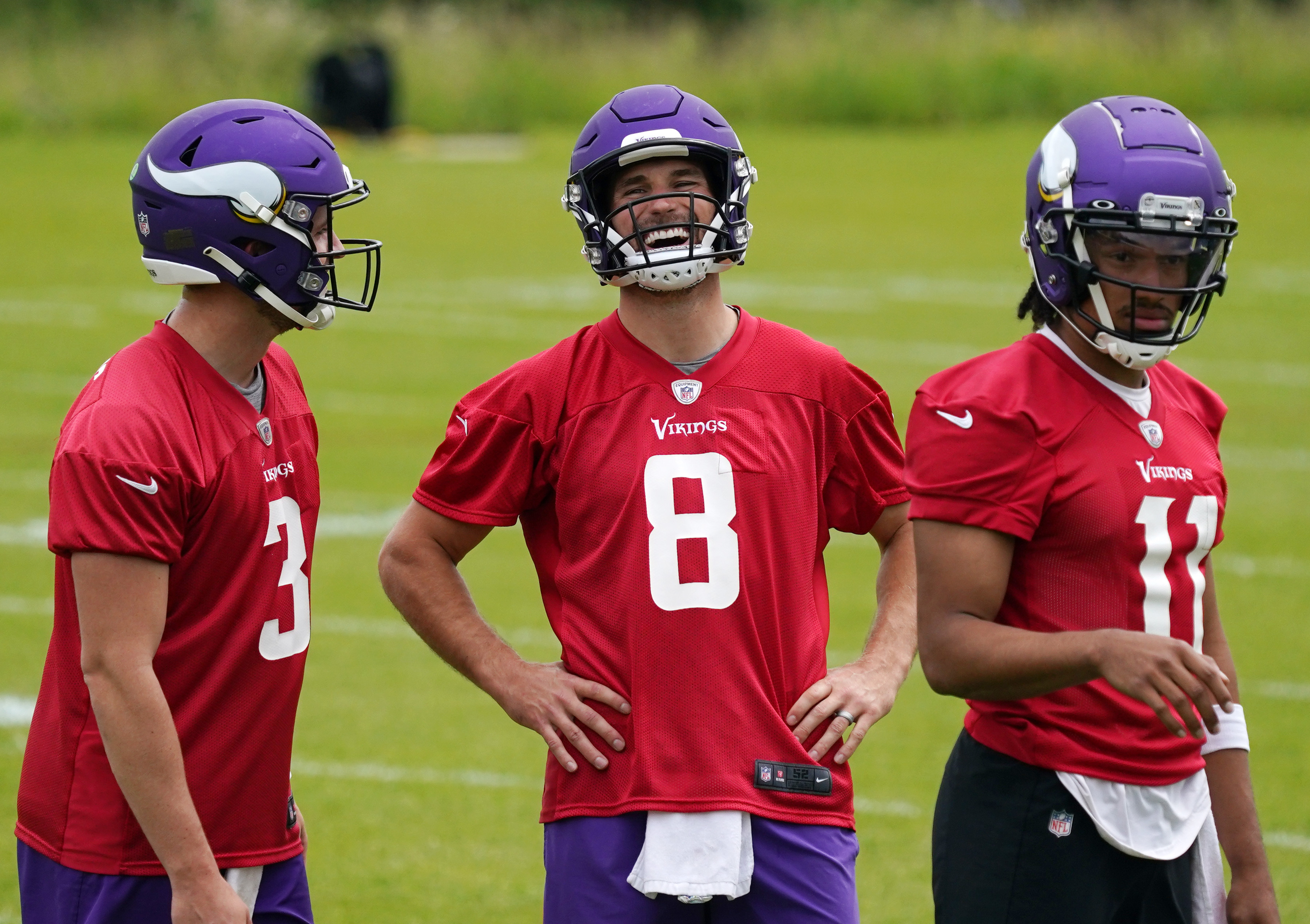 Kirk Cousins (8) with his fellow quarterbacks Jake Browning (3) and Kellen Mond (11) last week.