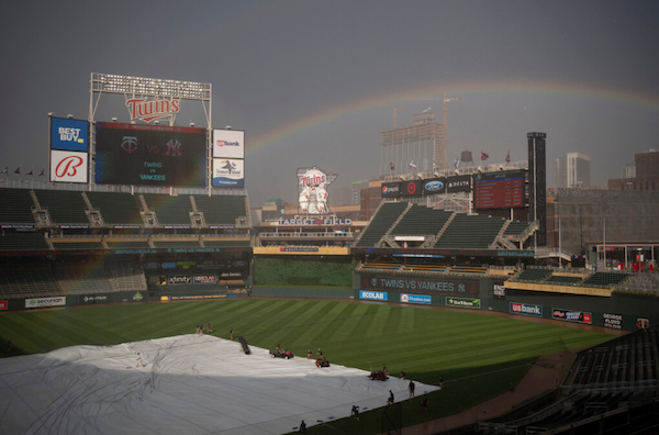 Wednesday's quick storm came with high winds that made it a battle to keep the tarp on the infield at Target Field.