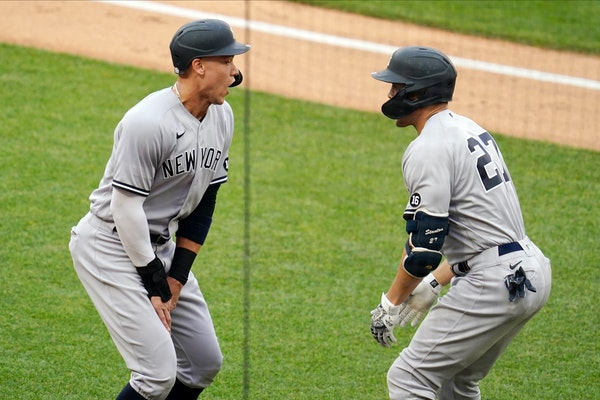 Giancarlo Stanton, right, celebrates his three-run, third-inning homer, snapping his monthlong home-run drought, with fellow Yankee Aaron Judge on Wed
