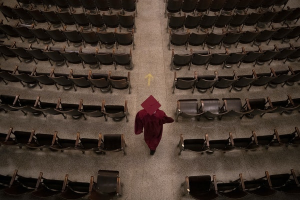 In this file photo, a Duluth Denfeld High School graduating senior walked into the auditorium in May 2020. ALEX KORMANN • alex.kormann@startribune.c