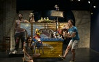 """The artistic team behind Open Eye Theatre's Driveway Tour show """"The Amazing Cowboat"""": performers Ty Chapman & Tri Vo, and assistant director/pup"""