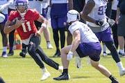 Minnesota Vikings quarterback Kellen Mond, left, scrambles during practice Wednesday, June 9, 2021, in Eagan, Minn. (Carlos Gonzalez/Star Tribune via